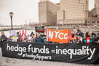 A coalition of community groups protests at the North Cove Marina in Battery Park on Tuesday, March 31, 2015 against the tax breaks written into the New York State budget for buyers of luxury yachts and private airplanes. Buyers of yachts would only pay tax on the first $230,000, topping off at $9200, of the cost no matter how expensive the yacht was. If you buy a plane you pay no sales tax at all if it carries fewer than 20 people.  (© Richard B. Levine)