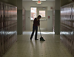 Yarely Arellano sweeps a hallway in the Lydia Paterson Institute in El Paso, Texas. Arrelano, 20, travels across the border every day from her home in Juarez, Mexico, to study at the United Methodist-sponsored high school. She repays part of her scholarship by spending two hours a day cleaning the school.