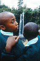Kenya. Rift Valley Province. Nyahururu. Schoolboys on a tourist trip at Thomson Falls. The boys wear a green uniform. © 2004 Didier Ruef