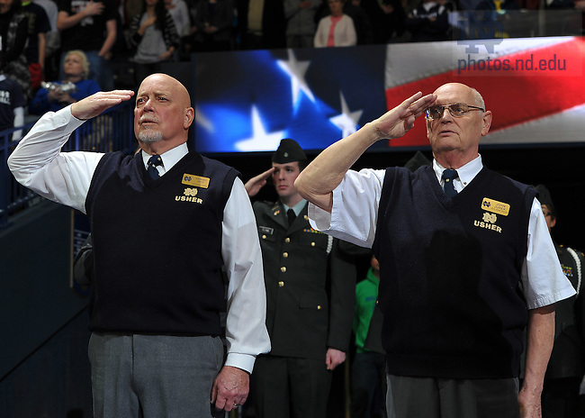 Feb. 28, 2011; Ushers salute during the National Anthem...Photo by Matt Cashore