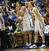 Allison Vernerey and Kathleen Scheer cheer on their teammates from the bench in the second half. Duke woman's basketball beat Virginia 77-66 on Monday, January 2, 2012 at Cameron Indoor Stadium in Durham, NC. Photo by Al Drago.