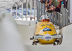 9 January 2016: Germany pilot Maximilian Arndt leads his 4-man team as they cross the finish line after their second run of the day at the BMW IBSF World Cup Bobsled Championships at the Olympic Sports Track in Lake Placid, New York, USA. Arndt's team won the gold with a 2-run combined time of 1:49.70. Mandatory Credit: Ed Wolfstein Photo *** RAW (NEF) Image File Available ***