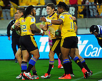 Beauden Barrett is swamped by teammates after his try during the Super Rugby match between the Hurricanes and Stormers at Westpac Stadium, Wellington, New Zealand on Friday, 2 April 2015. Photo: Dave Lintott / lintottphoto.co.nz
