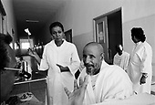 "Asmara, Eritrea.November 2002.Birhan Aim Hospital  (Light to the Eye Hospital)..A delighted Coptic Priest sees light for the first time through what was a cataract blind eye and proclaims that the doctor has, ""the hands of Christ?."