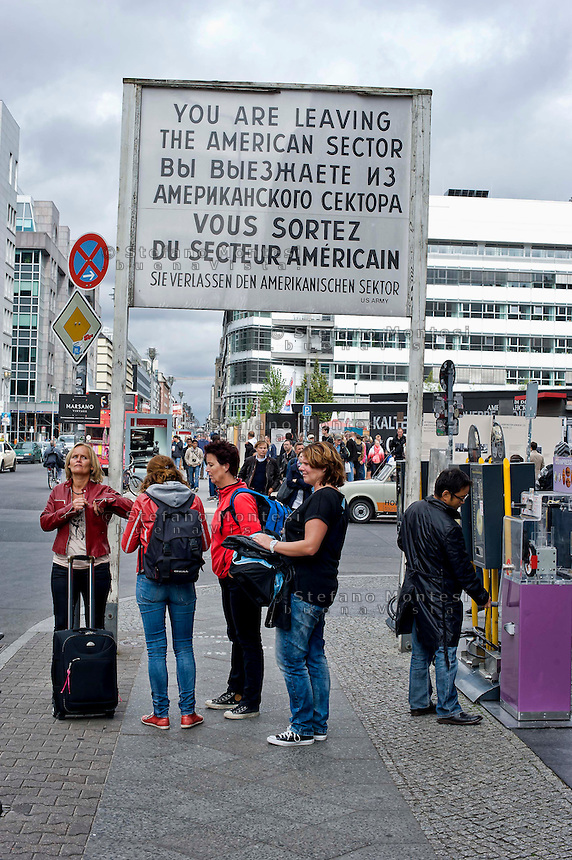 Berlin 15 September 2013<br /> Cold War sign at Check Point Charlie, Cold War sign at Check Point Charlie Germany states that &quot;you are leaving the American sector&quot; in Russian, English and French