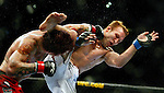 "UFC Middleweight ""Swing"" fighter Chris Leben gets in a powerful punch on Jake Rosholt who misses with a kick during their bout. The UFC 102 live from the Rose Garden featured many fights with Rosholt winning this one by submission."
