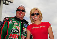 Feb. 19, 2012; Chandler, AZ, USA; NHRA funny car drivers John Force (left) and daughter Courtney Force during the Arizona Nationals at Firebird International Raceway. Mandatory Credit: Mark J. Rebilas-