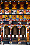 Asia, Bhutan, Thimpu. Three prayer wheels in a central square in Thimpu, Bhutan.
