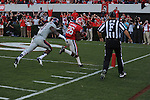 Georgia cornerback Malcolm Mitchell (26) scores against Ole Miss defensive back Dehendret Collins (1) at Sanford Stadium in Athens, Ga. on Saturday, November 3, 2012. Georgia won 37-10.