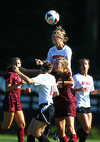 WINSTON-SALEM, NORTH CAROLINA - August 30, 2013:<br />  Erin Yenney (16) of Louisville University rises above Ashley Meier (15) of Virginia Tech to head the ball clear during a match at the Wake Forest Invitational tournament at Wake Forest University on August 30. The game ended in a 1-1 tie.