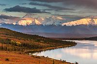 Mt Brooks and the Alaska range bordering Wonder lake and the autumn colored tundra, Denali National Park, Alaska.