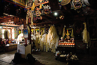 The monastery at Pangboche was built centuries ago around a rock where the famous lama Sangwa Dorje once meditated, the dim interior is filled with the ritual objects, thangkas, butter candles, and statues. During summit season, the monks are busy with daily blessings for the safety of climbers.