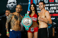 Puerto Rico boxer Miguel Cotto (L ) and Australia boxer Daniel Geale (R ) pose for pictures during an official weigh-in ahead of his fight against  at Barclays Center in New York.  06/05/2015. Eduardo MunozAlvarez/VIEWpress