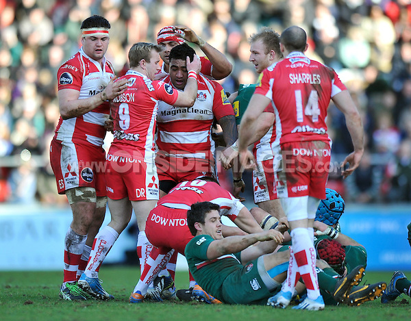 Sila Puafisi is congratulated by his team-mates after a big tackle on Anthony Allen. Aviva Premiership match, between Leicester Tigers and Gloucester Rugby on February 16, 2014 at Welford Road in Leicester, England. Photo by: Patrick Khachfe / JMP