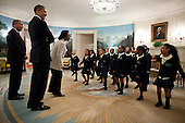 """United States President Barack Obama and Governor Deval Patrick (Democrat of Massachusetts) listen as students from Orchard Gardens K-8 School in Roxbury, Massachusetts, perform Dr. Martin Luther King Jr.'s """"I Have a Dream"""" speech in the Diplomatic Reception Room of the White House, February 28, 2012. .Mandatory Credit: Pete Souza - White House via CNP"""