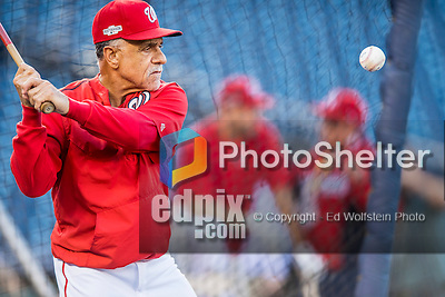 13 October 2016: Washington Nationals First Base Coach Davey Lopes taps out infield grounders during pre-game practice prior to Game 5 of the NLDS against the Los Angeles Dodgers at Nationals Park in Washington, DC. The Dodgers edged out the Nationals 4-3, to take Game 5 of the Series, 3 games to 2, and move on to the National League Championship Series against the Chicago Cubs. Mandatory Credit: Ed Wolfstein Photo *** RAW (NEF) Image File Available ***