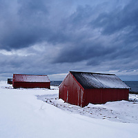 Boat sheds in snow, Eggum, Vestvågøy, Lofoten islands, Norway