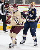 Chris Calnan (BC - 11), Eric Johnson (ND - 23) - The Boston College Eagles defeated the visiting University of Notre Dame Fighting Irish 4-2 to tie their Hockey East quarterfinal matchup at one game each on Saturday, March 15, 2014, at Kelley Rink in Conte Forum in Chestnut Hill, Massachusetts.
