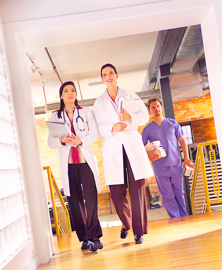 Female doctors walking and having a conversation in hospital
