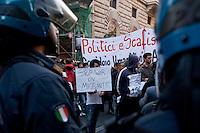 Roma 21 Aprile 2015<br /> Manifestazione  nazionale delle associazioni di migranti, sindacati e ONG, in Piazza Montecitorio, all&rsquo;indomani del naufragio che ha causato la morte di 900 migranti, per chiedere un corridoio umanitario e una politica di accoglienza dignitosa. Nella foto: La polizia blocca i manifestanti che volevano arrivare alla sede del parlamento europeo.<br /> Rome April 21, 2015<br /> National demonstration of migrant associations, trade unions and NGOs, in Piazza Montecitorio, in the aftermath of the wreck that caused the death of 900 migrants, ask for a humanitarian corridor and a policy of dignified reception. Pictured: Police block protesters who wanted to get to the seat of the European parliament.