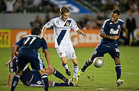 CARSON, CA - September 1, 2012: LA Galaxy midfielder Michael Stephens (26) and Vancouver midfielder Matt Watson (16) during the LA Galaxy vs the Vancouver Whitecaps FC at the Home Depot Center in Carson, California. Final score LA Galaxy 2, Vancouver Whitecaps FC 0.