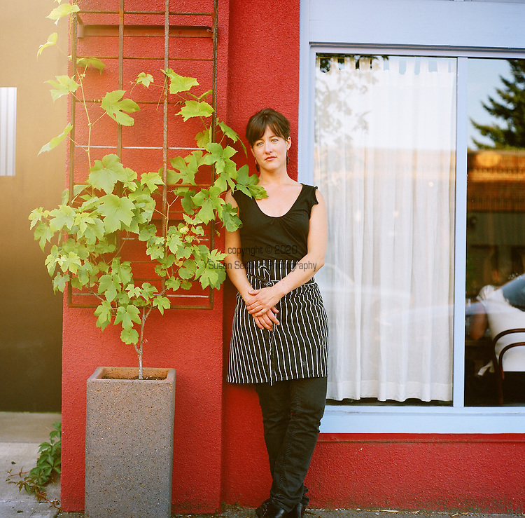 """Beast is a six-course, prix fixe restaurant in NE Portland, Oregon whose menu changes every Wednesday.  Chef (and single mom) Naomi Pomeroy and sous chef Micah Paredes focus on local ingredients in a style which they call """"refined French grandmother.""""  Pictured here is Naomi Pomeroy standing just outside the restaurant."""
