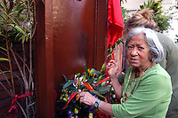 Roma 19 Maggio 2007..Carla la mamma di Valerio Verbano, ucciso dai fascisti nella sua abitazione nel 1980,davanti alla lapide che ricorda il figlio.  Carla pulisce la lapide dopo l'attentato incediario di questa notte.Carla's mother Valerio Verbano, killed by fascists in his home in 1980, in front the headstone that recalls the son..http://it.wikipedia.org/wiki/Valerio_Verbano.