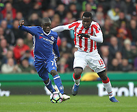 Stoke City's Mame Biram Diouf battles with Chelsea's Ngolo Kante<br /> <br /> Photographer Mick Walker/CameraSport<br /> <br /> The Premier League - Stoke City v Chelsea - Saturday 18th March 2017 - bet365 Stadium - Stoke<br /> <br /> World Copyright &copy; 2017 CameraSport. All rights reserved. 43 Linden Ave. Countesthorpe. Leicester. England. LE8 5PG - Tel: +44 (0) 116 277 4147 - admin@camerasport.com - www.camerasport.com