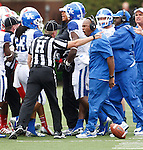 UK Head Coach Joker Phillips yells at the referee during the first half of the UK vs. UL football game at Papa John's Cardinal Stadium in Louisville, Ky., on Sunday, September 2, 2012. Photo by Tessa Lighty | Staff