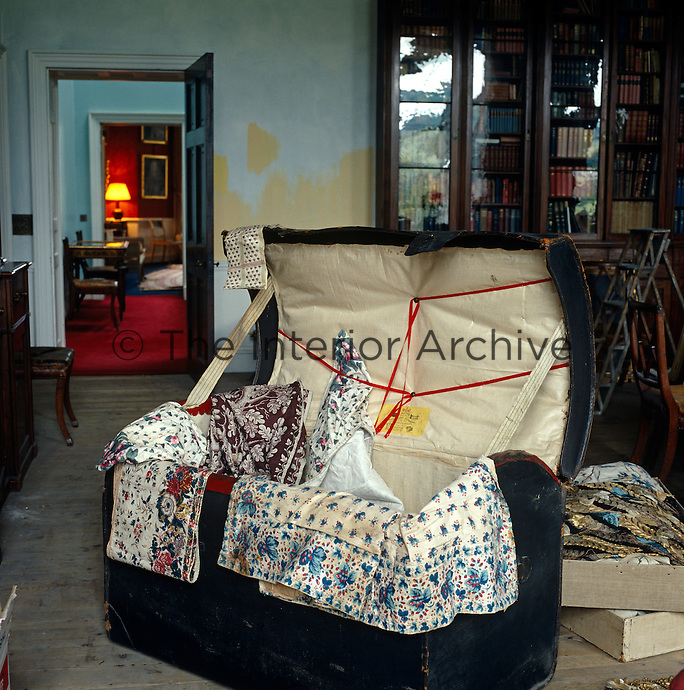 In the library stands a trunk full of original chintz curtains made for the house in the 19th century