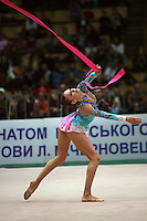 """Evgenia Kanaeva of Russia performs with ribbon at 2008 World Cup Kiev, """"Deriugina Cup"""" in Kiev, Ukraine on March 22, 2008."""