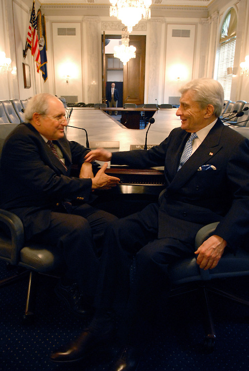 Ranking Member of the Senate Armed Services Committee, Carl Levin, D-Mich., left, and Chairman John Warner, R-Va., talk about the their recently cast 10,000th vote in the Senate.