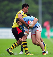 Santiago Gutierrez of Argentina is tackled. FISU World University Championship Rugby Sevens Men's 7th/8th/9th place play-off between Malaysia and Argentina on July 9, 2016 at the Swansea University International Sports Village in Swansea, Wales. Photo by: Patrick Khachfe / Onside Images