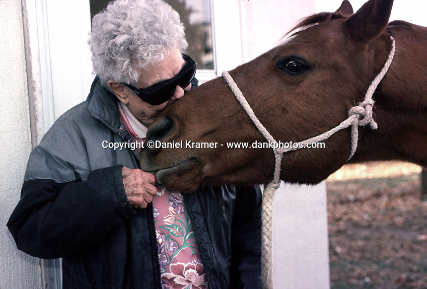 My second visit occurred just before Thanksgiving Day and stretched through Bobby's 89th birthday: Dec. 1, 2002. She had cataract surgery over the summer and couldn't ride but Josie would bring Big Red to the door so Bobby could feed him some sweets.