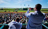 LEXINGTON, KENTUCKY - APR 07: Two men take photos of an undercard race on opening day at Keeneland Race Course on April 7, 2017 in Lexington, Kentucky. (Photo by Scott Serio/Eclipse Sportswire/Getty Images)