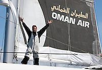 24th August 2010. Lands End. UK..Sidney Gavignet (FRA) skipper of the Oman Air - Majan trimaran. Pictured here celebrating after smashing the solo non stop round britain record and setting a new time of 4 days,15 hours and 10 minutes..Mandatory credit: Lloyd Images