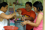 Women in Kahayag, on the southern Philippine island of Mindanao, making medicines from natural materials.
