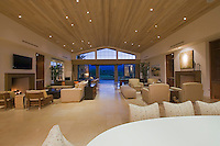 Large modern family and living room featuring beautiful tongue-in-groove ceilings and contemporary furniture featuring opposing fire places