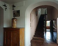 The original servants' bells are still hanging in the servants' hallway with its stone-flagged floor and worn wooden staircase