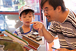 Joey Chung and his son Sebastian, of San Jose, point at a model train display during the Los Altos Train Days.