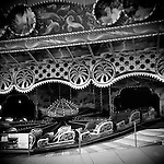 Monochrome Holga carnival image with Himalaya or bobsled ride