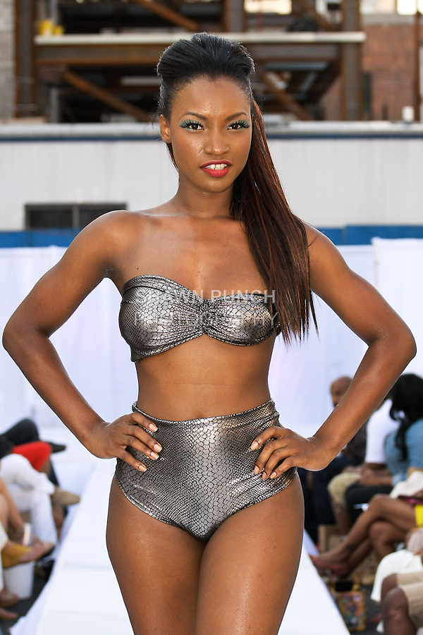 Model walks runway in a Marseille Fashion swimsuit by Nabu &amp; David, during the JRG Bikini Under The Bridge 2012 fashion show on July 9, 2012.