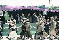 General Abdul Quassim Fahim with President Borhan'udin Rabani and Warlord Ahmad Shah Massoud at a Mudjahedin parade, celebrating the liberation of Charikar from the communist army.