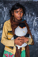 Momina, 12, poses for a portrait with a soft toy in the Guria Non-Formal Education center in the middle of the Shivdaspur red light district, Varanasi, Uttar Pradesh, India on 20 November 2013. Guria uses the soft toys as a form of therapy for the children of the women in prostitution and also use it as signals of the children's emotional wellbeing.