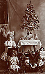 Little girl with several dolls and Christmas tree. vintage image.  kids, girls, play, dolls, toys, holidays