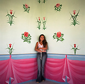 Nadia, 14 year old Roma girl in one of the highly decorated rooms of her parents house in the new part of Sintesti Roma camp. Two weeks after this picture was taken Nadia was due to be married. Sintesti roma camp.