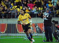 Photographer Mike Moran shows his amazement at Ma'a Nonu's intercept try during the Super Rugby match between the Hurricanes and Chiefs at Westpac Stadium, Wellington, New Zealand on Saturday, 16 May 2015. Photo: Dave Lintott / lintottphoto.co.nz