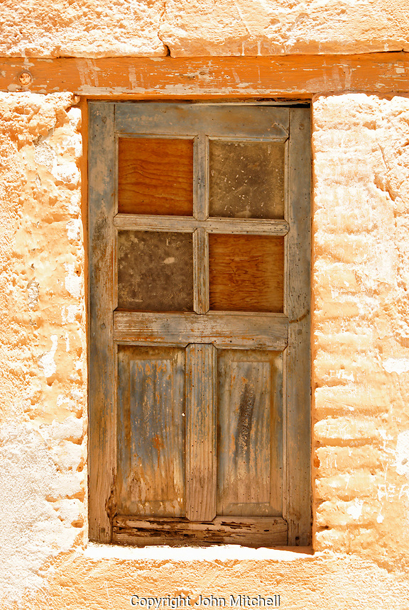 Old shuttered  window of a house  in the 19th century mining town of Mineral de Pozos, Guanajuato, Mexico.