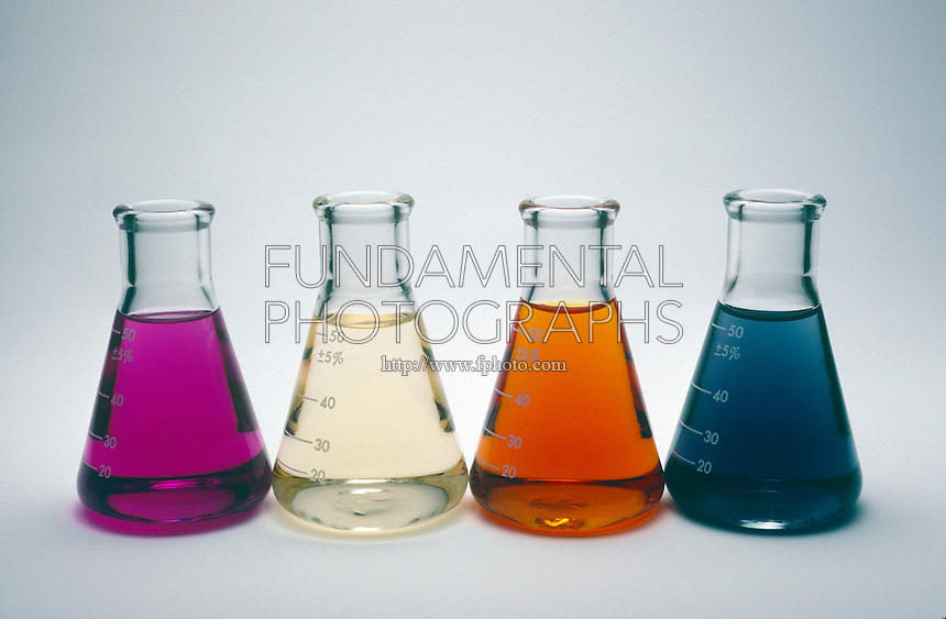 IODINE SOLUTIONS<br /> Solutions Of Iodine In A Variety of Solvents<br /> Tetrachloromethane (carbon tetrachloride), water and potassium iodide solutions, in which brown I3- ion forms. Starch has been added to the solution on the right, resulting in blue color.