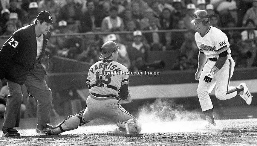 Steve Garvey is out at home tagged by catcher Lance Parrish, umpire Lee Weyer. 1984 All-Star game in San Francisco. (photo/Ron Riesterer)